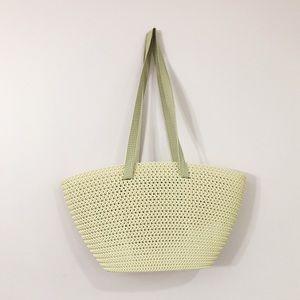 Spacious plastic woven beach bag